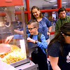 Baker scoops popcorn to deliver and sell as part of his Life Skills class at Western Middle School on October 11. Baker has learning disabilities due to mitochondrial disease, so his parents want him to get the most he can out of different life skills that he can apply to the real world in adulthood.<br /> Kelly Lafferty Gerber | Kokomo Tribune
