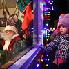 2-year-old Axlynn Rylands, with the help of her grandpa Scott Hileman, takes a peek inside Santa's House to get a glimpse of Santa Claus during downtown Peru's Christmas open house on Wednesday, November 14, 2018.<br /> Kelly Lafferty Gerber | Kokomo Tribune