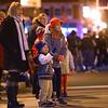Alisha Denham, left, along with her son Jace Denham, 4, and 10-year-old Brooklynn Hahn, watch the start of the Christmas parade during downtown Peru's Christmas open house on Wednesday, November 14, 2018.<br /> Kelly Lafferty Gerber | Kokomo Tribune