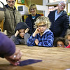 From left: Julian Middlesworth, 7, Phinehas Middlesworth, 8, Coralie Middlesworth, 3, and Della Middlesworth, 5, watch a glass cutting demonstration during their tour at Kokomo Opalescent Glass on Friday, November 23, 2018.<br /> Kelly Lafferty Gerber | Kokomo Tribune