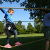 Eden Hoppes, 6, from Cub Scout Pack 3506 in Kokomo, tries to maintain her balance during the rope challenge during the Welcome to Scouting event at Jackson Morrow Park in September.<br /> Kelly Lafferty Gerber | Kokomo Tribune