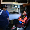 Allayna Grimes, 8, a Bear in Cub Scout Pack 3506, tests out the seat in an ambulance during a Cub Scout Pack meeting in October. Emergency vehicles were opened to the boys and girls in Pack 3506 so they could learn more about EMT's, paramedics, and firefighters.<br /> Kelly Lafferty Gerber | Kokomo Tribune
