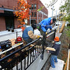 Dustin Whelchel, Mike McCuan and John Corson install the new steel railings along the Wildcat Creek between Union and Main Streets on Nov, 2, 2018. Bowyer Excavation is fabricating the rails and Cosmo Construction is installing them over the next 2 weeks as the pieces are finished.<br /> Tim Bath | Kokomo Tribune