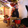 11-29-18<br /> Brooke Johnson and Nate Wyant, along with their dog Bronco, pose for photos at We Care Park on Thursday, November 29, 2018. We Care Park will be featured on The Great Christmas Light Fight on ABC, Monday at 8 p.m.<br /> Kelly Lafferty Gerber | Kokomo Tribune