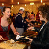 Last year's winner Lauren Powell, left, serves up her dish to Angie Heckman during the Community Howard Regional Health Foundation Chef's Bash on Saturday, November 10, 2018.<br /> Kelly Lafferty Gerber | Kokomo Tribune