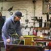 Jeff Simmons works in the hot glass studio at Kokomo Opalescent Glass on Friday, November 23, 2018.<br /> Kelly Lafferty Gerber   Kokomo Tribune