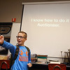 "Baker gives a demonstration of his auctioneering skills during a career presentation in ""The Hub,"" Western Middle School's special education class, on October 11. He's got an outgoing personality, and he's never been nervous during an auction, he said. <br /> Kelly Lafferty Gerber 
