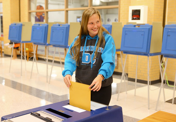 First-time voter 18-year-old Jessie Jones submits her sealed envelope containing her ballot during early voting at Northwestern School on Thursday, November 1, 2018.<br /> Kelly Lafferty Gerber | Kokomo Tribune