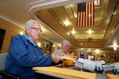 Jack Welker helps to open absentee and early voting envelopes and take out the ballots so they can be counted on Election Day, Tuesday, November 6, 2018, at the Howard County Courthouse. Kelly Lafferty Gerber   Kokomo Tribune