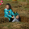 Siblings Gabby Thieke, 5, and Elliot Thieke, 2, laugh as they try to figure out how to get out of the mini straw maze at Kendall Family Farm Adventures on Saturday, October 20, 2018.<br /> Kelly Lafferty Gerber | Kokomo Tribune