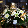 Pine centerpiece with Mercury Glass Snowman, white lillies, Christmas greens, frosted pine cones, white flower and gold accents on Oct. 16, 2018. <br /> Tim Bath | Kokomo Tribune