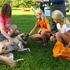 Monica Skinner, left, along with 8-year-old Braylee Skinner and 9-year-old Alyssa Skinner oblige their german shepherd Krieger with a belly rub and a head scratch at Barktoberfest in Foster Park on Saturday, October 6, 2018.<br /> Kelly Lafferty Gerber | Kokomo Tribune
