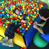 Allie Hoff, 16, has some fun in the ball pit as she spends time with Tim Baughman, physical therapy assistant, at Hopebridge Autism Therapy Center in Kokomo on October 18, 2018.<br /> Kelly Lafferty Gerber | Kokomo Tribune