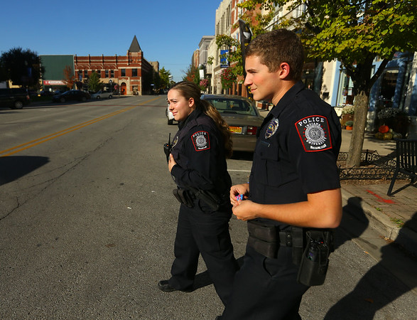 IU Kokomo police department officers Emily Doran, left, and Braxton Campbell return to their vehicle after doing a security check on the IUK art gallery in downtown Kokomo on Thursday, October 18, 2018.<br /> Kelly Lafferty Gerber | Kokomo Tribune