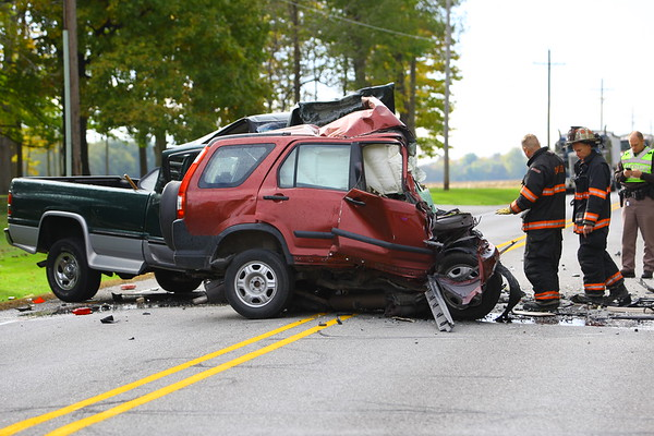 Howard County Coroner Steve Seele investigates a fatal accident at 600 West and 100 North Thursday afternoon on Oct. 25, 2018. <br /> Tim Bath   Kokomo Tribune