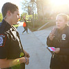 Emily Doran, right, an IU Kokomo police officer first class talks to dispatch about a welfare check as she and IUK cadet officer Braxton Campbell, left, work on Thursday, October 18, 2018.<br /> Kelly Lafferty Gerber | Kokomo Tribune