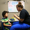 Registered behavior technician Rae Ann Long, right, uses flashcards as she works with 4-year-old Dylan Anaya at Hopebridge Autism Therapy Center in Kokomo on October 18, 2018.<br /> Kelly Lafferty Gerber | Kokomo Tribune