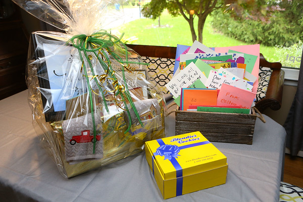 Susan Tobin organized with Greentown businesses and Eastern students to create a welcome basket to a Greentown family who were recently targeted by a letter that contained derogatory racial comments towards the family's adopted black child.<br /> Kelly Lafferty Gerber | Kokomo Tribune