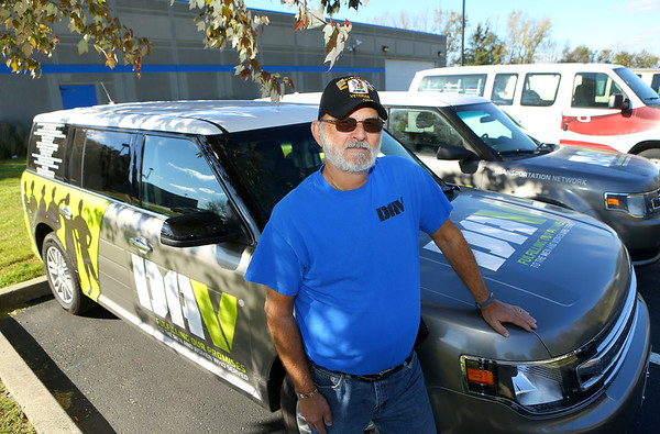 Bob King, one of the Disabled American Veterans Local 28 drivers, stands in front of the new van that the community pitched in on to help buy.<br /> Kelly Lafferty Gerber | Kokomo Tribune
