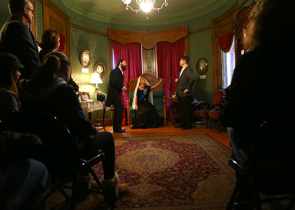"""Guests watch as Queen Victoria, center, played by Anna Ely, speaks with Dr. Gull, left, played by G.W. Welsh, and Sherlock Holmes, played by Jordan Kenyon. """"From the Dark Pages,"""" a live action murder mystery tour tracking Jack the Ripper and meeting characters and authors from Victorian Gothic literature, took place at the Seiberling Mansion on Friday, October 19, 2018. Tours continue Saturday from 5-9 p.m.<br /> Kelly Lafferty Gerber   Kokomo Tribune"""