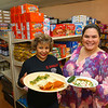 Sonia Islas, left, and Grethel Keeney hold plates of food at El Borrego Carniceria y Taqueria at 314 S. Union Street on Tuesday, October 23, 2018.<br /> Kelly Lafferty Gerber | Kokomo Tribune