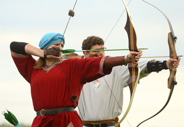 Meriah Tigner, left, from Kokomo, and Tyler Keiter from Elizabethtown, Kentucky, participate in archery during the Clown Tourney at the Miami County Fairgrounds on Saturday, October 6, 2018.<br /> Kelly Lafferty Gerber | Kokomo Tribune