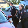 Emily Doran, right, and Braxton Campbell, officers with the IU Kokomo police department, make sure that the woman sitting in her car was not in a traffic accident after hearing a minor car accident call dispatched over the scanner on Thursday, October 18, 2018.<br /> Kelly Lafferty Gerber | Kokomo Tribune