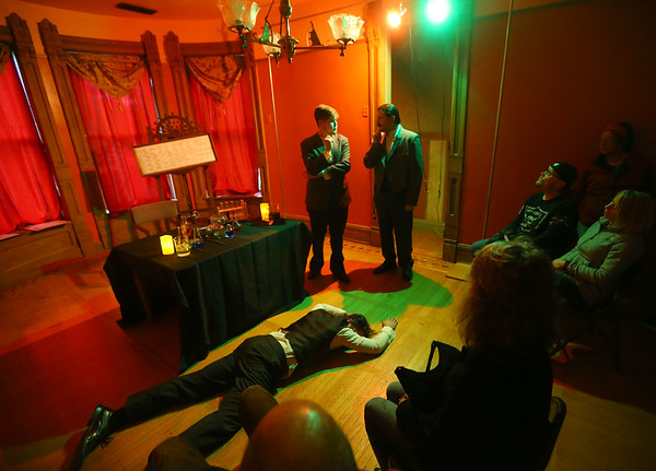 """Dr. Jekyll/Mr. Hyde, played by Nolan Vent, lays motionless on the floor as Sherlock Holms, left, played by Jordan Kenyon, and Sir Arthur Conan Doyle, played by Jay Ashcraft discuss the situation. The three were some of the characters portrayed in a live action murder mystery tour at the Seiberling Mansion called """"From the Dark Pages."""" Guests went from room to room in the Seiberling tracking Jack the Ripper and meeting characters and authors from Victorian Gothic literature on Friday, October 19, 2018. Tours continue Saturday from 5-9 p.m.<br /> Kelly Lafferty Gerber 