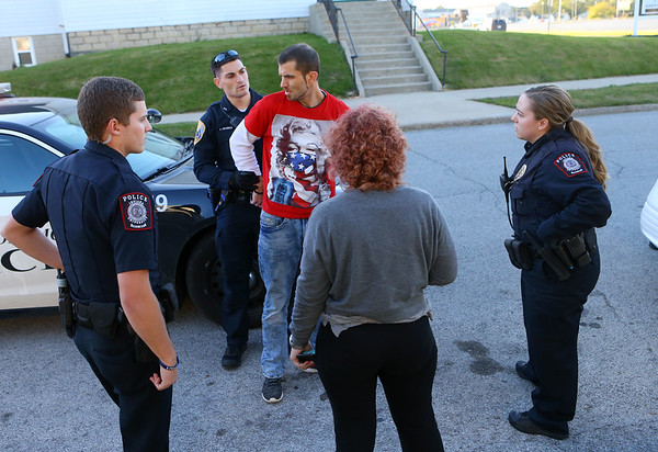IU Kokomo cadet officer Braxton Campbell, left, and IU Kokomo police officer first class Emily Doran, right, assist the Kokomo Police Department at a traffic stop and arrest on Thursday, October 18, 2018.<br /> Kelly Lafferty Gerber | Kokomo Tribune