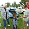 Jaicion Rinearson, 5, hands Aaron Glunt, 10, a Hot Wheels car on behalf of the VW Club during Oktoberfest Volkswagen Cruise-In on Saturday, September 22, 2018, in Foster Park.<br /> Kelly Lafferty Gerber | Kokomo Tribune