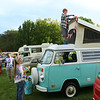 10-year-old Cooper Cass, from Noblesville, puts up decoration on his parents' 1974 Westfalia Camp Mobile parked in Foster Park for the Oktoberfest Volkswagen Cruise-In on Saturday, September 22, 2018.<br /> Kelly Lafferty Gerber | Kokomo Tribune
