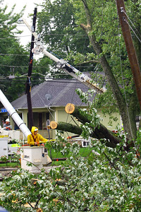Jerry Turner with Burford's Tee removing a tree that is across utility lines at the corner of Webster and State Streets on Sept. 7, 2018. A utility pole was snapped by the falling tree that was still resting across one of the cables. Tim Bath | Kokomo Tribune