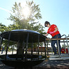 Kinzey Poe paints playground-sized saucers at Taylor Elementary on Friday, September 28, 2018. Lowes installed $16,000 worth of playground equipment at Taylor Elementary on Friday.<br /> Kelly Lafferty Gerber | Kokomo Tribune