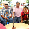 From left: Rob Jenkins, from Pennsylvania, along with Francis Stumblingbear and his son 7-year-old Ashkii Stumblingbear, from Oklahoma, were part of the Southern Singers who sang and kept the beat during gourd dancing at the Tecumseh Lodge Powwow at the Tipton County Fairgrounds on Saturday, September 1, 2018.<br /> Kelly Lafferty Gerber | Kokomo Tribune
