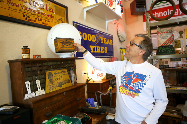 """Mauricio """"Mo"""" Gonzalez, shows an old oil can from Kokomo, part of his historic collection of artifacts from the area.<br /> Kelly Lafferty Gerber 