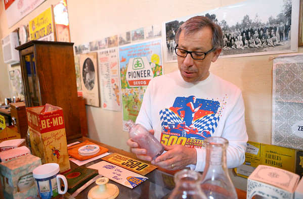 """Mauricio """"Mo"""" Gonzalez, shows artifacts from Tipton's history on March 28, 2019. Most are on display in his garage built just for his collection.<br /> Kelly Lafferty Gerber   Kokomo Tribune"""