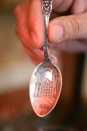 """Mauricio """"Mo"""" Gonzalez, shows a spoon with an engraving of the Tipton County Courthouse on March 28, 2019. Gonzalez collects artifacts from Tipton's history.<br /> Kelly Lafferty Gerber 
