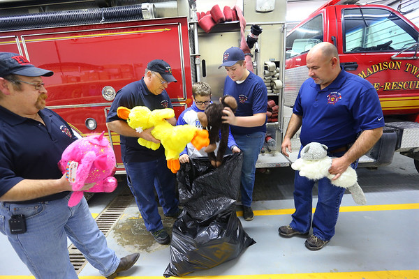 Ethan Wesner is a 6th grader at Tipton Middle School and has recently asked for a ton of stuffed animals for his birthday that he then delivered to fire and police. He drops a bag of them at Madison Twp. Volunteer Fire Department on December 27, 2019. Brian Lane, Chief Ken Kemper, Keegan Williams and Asst. Chief Jon Williams check out the animals that Ethan dropped.<br /> Tim Bath | Kokomo Tribune