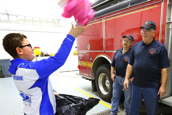 Ethan Wesner is a 6th grader at Tipton Middle School and has recently asked for a ton of stuffed animals for his birthday that he then delivered to fire and police. He drops a bag of them at Madison Twp. Volunteer Fire Department on December 27, 2019. He tosses one of the animals to chief Ken Kemper. Tim Bath | Kokomo Tribune