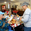 Linda Butler, left, and Kay French put together sandwiches and sack lunches on December 19, 2019, to give away at the trolley station in downtown Kokomo.<br /> Kelly Lafferty Gerber | Kokomo Tribune