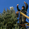 Chad Creason begins to put lights around the tree that the residents of Miami, Indiana put up in the middle of town, at the intersection of Elm and and Fulton streets on Saturday, December 7, 2019. The tree was cut down and donated by Creason.<br /> Kelly Lafferty Gerber | Kokomo Tribune