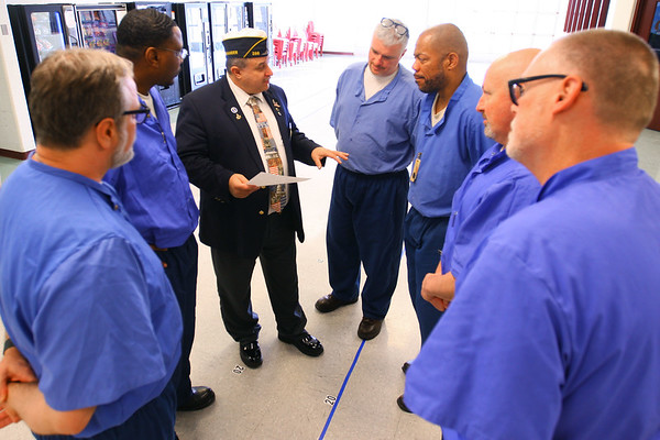 Member of the American Legion Post 555 located at Miami Correctional facility with almost a 100 members talk about their involvement on December 5, 2019. J. David Burnette Jr., Indiana American Legion District 5 commander works with some of the officers hashing out solutions.<br /> Tim Bath | Kokomo Tribune