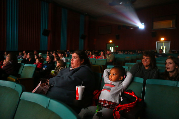 "Amiya Carter, 3, watches ""Wonder Park"" alongside Amber Sharp during Diana Theatre's 93rd annual free Christmas movie in Tipton on Saturday morning, December 21, 2019.<br /> Kelly Lafferty Gerber 