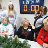 Fern Fennell talks with the highest bidder of the We Care sign on the phone as she talks with We Care President Becky Varnell in the phone operator room during the 2019 We Care telethon on Sunday, December 8, 2019.<br /> Kelly Lafferty Gerber | Kokomo Tribune
