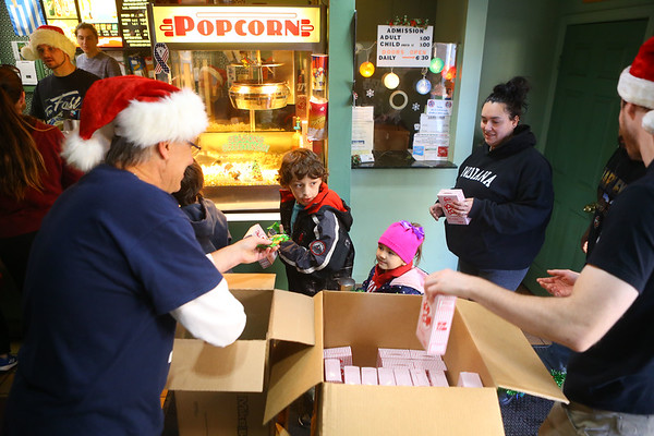 """Movie-goers receive free popcorn and candy during Diana Theatre's 93rd annual free Christmas movie, """"Wonder Park,"""" in Tipton on Saturday morning, December 21, 2019.<br /> Kelly Lafferty Gerber 