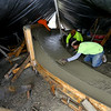 Shawn Gilmore, Chris Swartzengruber and Landy Callada who work for Hunger Skateparks finish concrete under a makeshift tent as work continues on the skatepark in Foster Park on December 9, 2019.<br /> Tim Bath | Kokomo Tribune