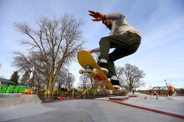 Taylor Shirek gets a little air over one of the ramps at the City of Kokomo's newest skate park located at Foster Park opens to a big crowd on December 23, 2019.<br /> Tim Bath | Kokomo Tribune