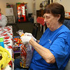 Edith Clemons adds chips to the sack lunch as she helps put them together on December 19, 2019, to give away at the trolley station in downtown Kokomo.<br /> Kelly Lafferty Gerber | Kokomo Tribune