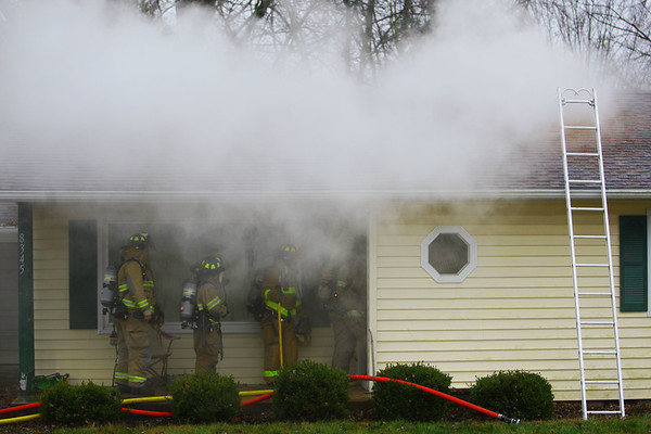 Greentown volunteer firefighers bring out a cage with two guinea pigs and clear the smoke after a fire at 8345 East 50 South in Greentown on Monday December 9, 2019.<br /> Tim Bath | Kokomo Tribune