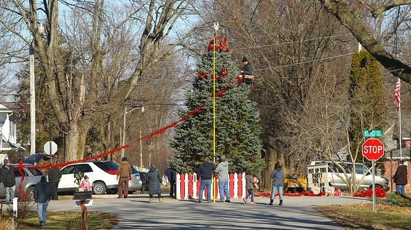 Garland is wrapped around the tree as the residents of Miami, Indiana continue an 80-year tradition of putting up a Christmas tree in the middle of town, at the intersection of Elm and and Fulton streets on Saturday, December 7, 2019.<br /> Kelly Lafferty Gerber | Kokomo Tribune